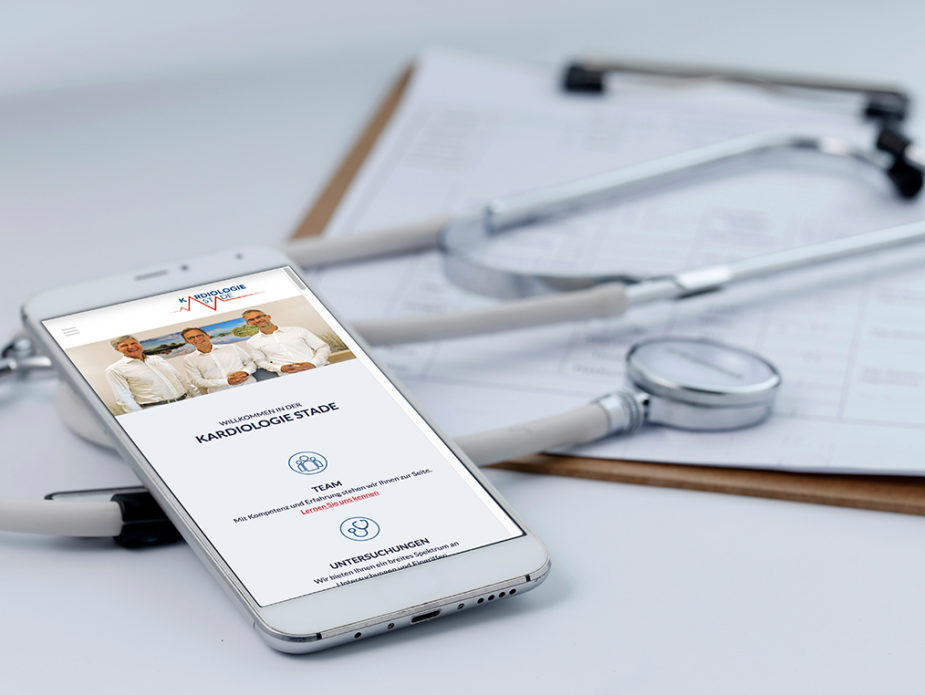 Mobile phone, stethoscope and chart file on the desktop (mobile medical, handheld doctor concepts)